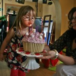 abbie blowing cake